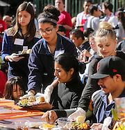 11月25日, 志愿者送上免费节日大餐。当天,在美国洛杉矶感恩节前夕,慈善社团为数千贫民区(Skid Row)居民和无家可归者提供免费节日大餐。(新华社发 赵汉荣摄)<br /> Volunteers serve Thanksgiving meal Wednesday November 25, 2015, in Los Angeles. Thousands of Skid Row residents and homeless people from downtown and beyond were served Thanksgiving dinners during the Los Angeles Mission's annual holiday feast.  (Xinhua/Zhao Hanrong)(Photo by Ringo Chiu/PHOTOFORMULA.com)<br /> <br /> Usage Notes: This content is intended for editorial use only. For other uses, additional clearances may be required.