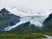 Drive to Worthington Glacier State Recreation Site near Thompson Pass in the Chugach Mountains, at milepost 28.7 of Richardson Highway east of Valdez, Alaska, USA. See one of the few US glaciers accessible by paved highway. Like most of Alaskas glaciers, this valley glacier has been steadily retreating for the last 150 years, but not as dramatically as many others. Thompson Pass is the snowiest place recorded in Alaska, with 551.5 inches (1,401 cm) of snow per year on average. The winter of 1952-1953 set an Alaskan record of more than 80 feet of snow. An Alaskan record snowfall of 62 inches (160 cm) fell in a single day, December 29, 1955.