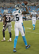 Carolina Panthers wide receiver Keyarris Garrett (15) flips the ball to an official after catching a 34 yard catch for a late fourth quarter first down that sets up a late Panthers score during the 2016 NFL preseason football game against the New England Patriots on Friday, Aug. 26, 2016 in Charlotte, N.C. The Patriots won the game 19-17. (©Paul Anthony Spinelli)