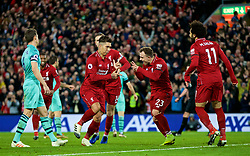LIVERPOOL, ENGLAND - Saturday, December 29, 2018: Liverpool's Roberto Firmino (L) celebrates scoring the fifth goal, with team-mate Xherdan Shaqiri, completing his hat-trick, during the FA Premier League match between Liverpool FC and Arsenal FC at Anfield. (Pic by David Rawcliffe/Propaganda)