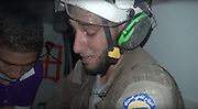 "Assad and Russian jet fighters carried out on Thursday new bombardment rounds on Idlib, leaving 11 civilians dead and more than 15 others injured.<br /> <br /> Syria's White Helmets or civil defense volunteers rushed to the scene to recover bodies and rescue the injured, transporting them to medical points.<br /> <br /> Abu Kifah, one of the civil defense volunteers, was among others searching the rubble for any survivors.<br /> <br /> After two hours' work, Abu Kifah and his colleagues were able rescue a 30-day-old baby from under the rubble.<br /> <br /> After recovering the baby girl, Abu Kifah burst into tears and held her tight to his chest while he got on an ambulance and took her to one of the makeshift hospitals in Idlib, as a video footage, published by one of the activists, showed.<br /> <br /> In the footage, Abu Kifah is seen holding the baby girl to his chest and getting on an ambulance.<br /> <br /> Abu Kifah did not let go of the girl and was weeping and saying ""O, Allah,"" as paramedics were cleaning some bruises which were on the baby's face.<br /> <br /> Moaz al-Shami, a citizen journalist, met Abu Kifah to ask him about rescuing the baby girl.<br /> ©Exclusivepix Media"