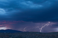 Rain storm with lightning at sunset over the Pajarito Plateau on the east side of the Jemez Mountains, © 2014 David A. Ponton