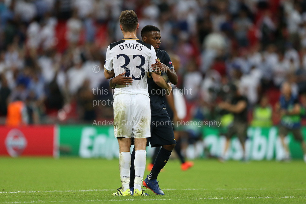 Ben Davies of Tottenham Hotspur hugs Thomas Lemar of AS Monaco after the final whistle. UEFA Champions league match, group E, Tottenham Hotspur v AS Monaco at Wembley Stadium in London on Wednesday 14th September 2016.<br /> pic by John Patrick Fletcher, Andrew Orchard sports photography.