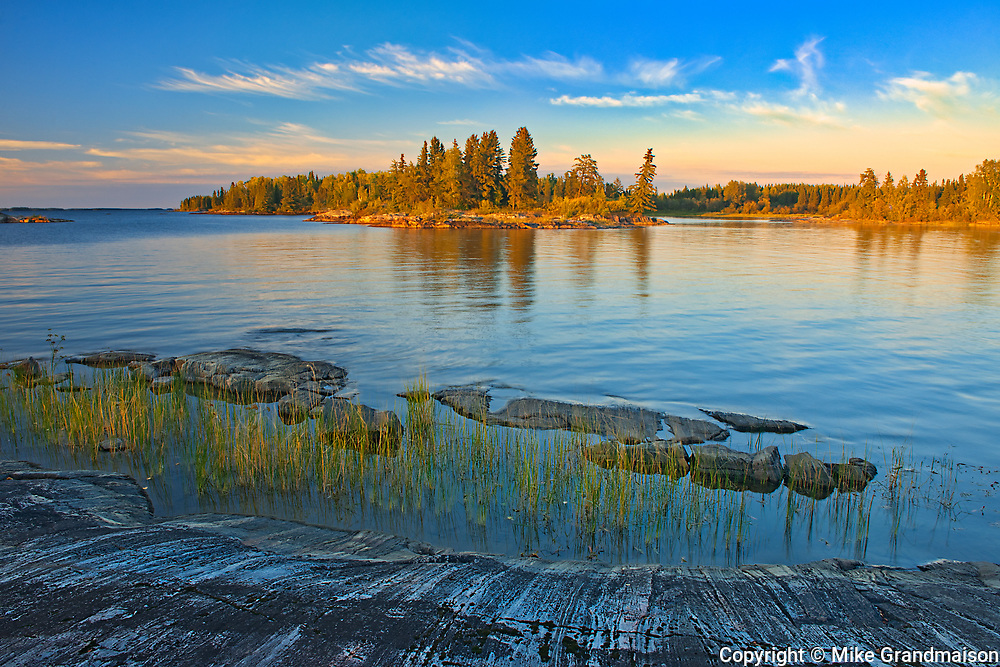 Rocky shoreline of Setting Lake at sunset<br />