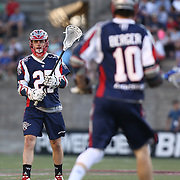 Kevin Buchanan #27 of the Boston Cannons passes the ball to Stephen Berger #10 of the Boston Cannons during the game at Harvard Stadium on May 17, 2014 in Boston, Massachuttes. (Photo by Elan Kawesch)