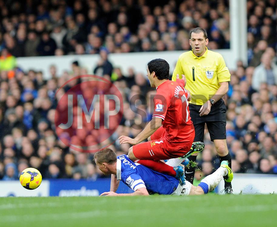 Liverpool's Luis Suarez falls on Everton's James McCarthy - Photo mandatory by-line: Dougie Allward/JMP - Tel: Mobile: 07966 386802 23/11/2013 - SPORT - Football - Liverpool - Merseyside derby - Goodison Park - Everton v Liverpool - Barclays Premier League