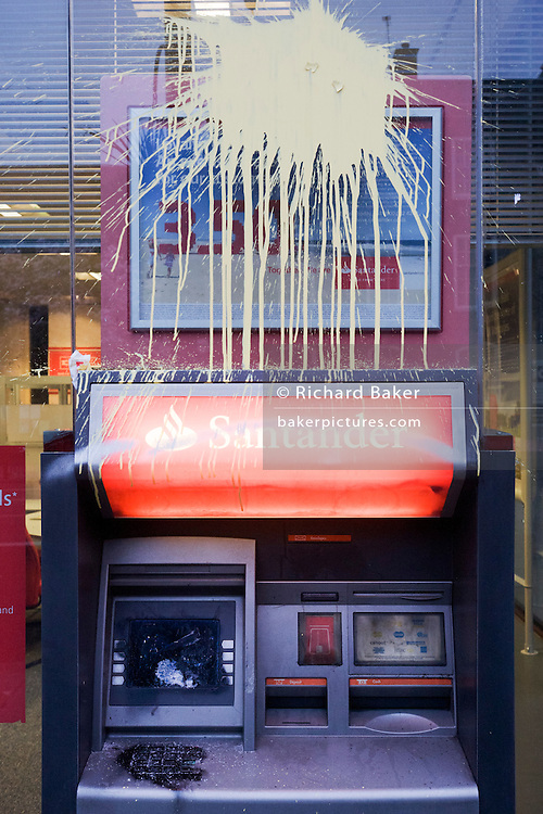 Vandalism by breakaway anarchists to Santander bank property the morning after the TUC-organised anti-government march against cuts to Britain's economy.