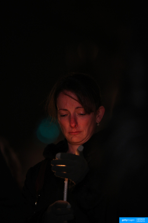 A women cries at a townwide community vigil on Sherman Green. Fairfield, Connecticut after the mass shootings at Sandy Hook Elementary School, Newtown, Connecticut, USA. 17th December 2012. Photo Tim Clayton