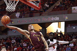 "10 January 2018:  Lucas Williamson stretches for the reverse while guarded by Daouda ""David"" Ndiaye during a College mens basketball game between the Loyola Chicago Ramblers and Illinois State Redbirds in Redbird Arena, Normal IL"