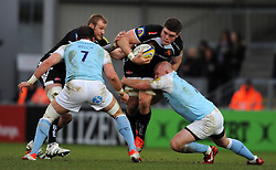 Exeter Chiefs Dave Ewers is tackled by Newcastle Falcons Scott Lawson  - Photo mandatory by-line: Harry Trump/JMP - Mobile: 07966 386802 - 14/02/15 - SPORT - Rugby - Aviva Premiership - Sandy Park, Exeter, England - Exeter Chiefs v Newcastle Falcons