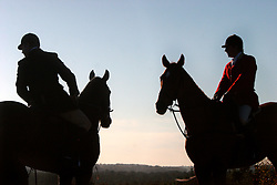 UK ENGLAND SURREY TILFORD 13NOV04 - Two hunters on horseback overlook a stretch of empty country belonging to the MoD during a foxhunt. Foxhunting in rural Surrey with the Surrey Hunters Union, founded in 1798. ....jre/Photo by Jiri Rezac ....© Jiri Rezac 2004....Contact: +44 (0) 7050 110 417..Mobile:  +44 (0) 7801 337 683..Office:  +44 (0) 20 8968 9635....Email:   jiri@jirirezac.com..Web:    www.jirirezac.com....© All images Jiri Rezac 2004 - All rights reserved.