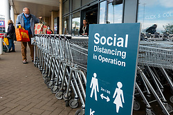 Edinburgh, Scotland, UK. 19 June, 2020. Several shops at Straiton Retail Park outside Edinburgh have opened. Signage warning customers to maintain 2m social distancing is positioned outside and inside shops. Pictured; M&S Food store is open and has long queues of customers. Iain Masterton/Alamy Live News