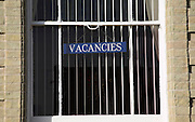 Vacancies sign in window. Seafront guest houses out of season, Lowestoft, Suffolk, England