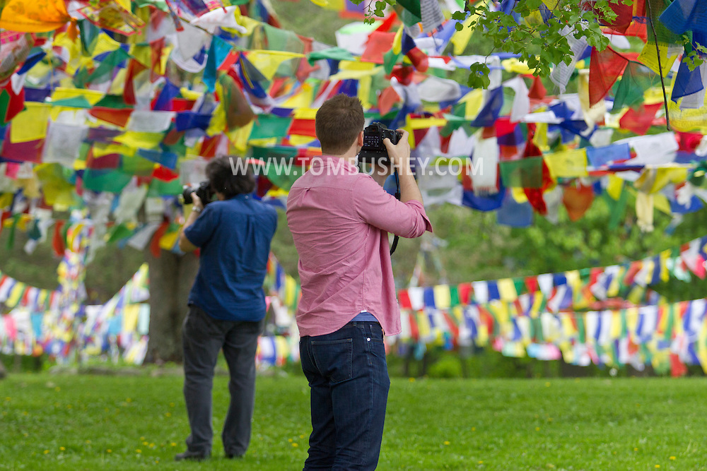 Walden, New York - Location managers photograph Tibetan Buddhist  prayer flags at the Tsechen Kunchab Ling (Temple of All-Encompassing Great Compassion)during a tour run by the Orange  County New York Film Office  on May 15, 2014.