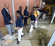 August , 2013 - Atlanta: Over 80 members of the 100 Black Men of Atlanta greeted the  African American boys and their parents as they arrived on the first day of school at at B.E.S.T Academy (Business Engineering Science Technology) on Wednesday, August 7 ,2013. .  The boys were inspired by former Atlanta Mayor Andrew Young to become leaders in the community.  Young spoke to boys in the middle school and high School.  The school is an all male school.  Today was the first day back to school for students in Atlanta. ©Johnny Crawford