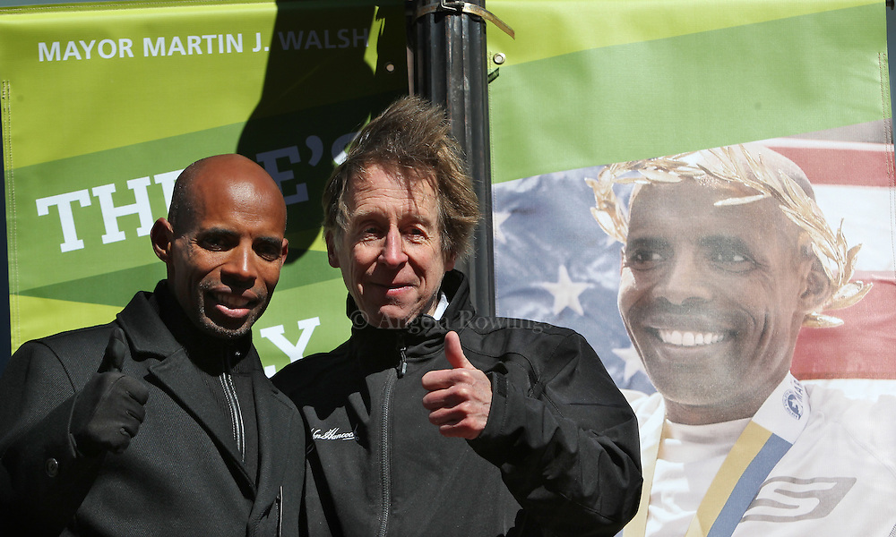 (Boston, MA - 3/19/15) Marathon champions Meb Keflezighi, left, and Bill Rodgers pose during the unveiling of the 2015 Boston Marathon street banners on Boylston Street, Thursday, March 19, 2015. Staff photo by Angela Rowlings.
