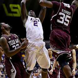 Jan 23, 2013; Baton Rouge, LA, USA; LSU Tigers forward Johnny O'Bryant III (2) shoots over Texas A&M Aggies forward Ray Turner (35) and forward Kourtney Roberson (32) during the second half of a game at the Pete Maravich Assembly Center. LSU defeated Texas A&M 58-54. Mandatory Credit: Derick E. Hingle-USA TODAY Sports