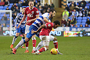 Reading forward Orlando Sa tackles Bristol City midfielder Korey Smith during the Sky Bet Championship match between Reading and Bristol City at the Madejski Stadium, Reading, England on 2 January 2016. Photo by Jemma Phillips.
