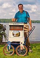Bob Y cranking hand organ at Organ Rally at Quassy Amusement Park, Connecticut, USA, on August 2012