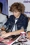 22.AUGUST.2013. LONDON<br /> <br /> UNION J SIGN COPIES OF THEIR POSTER FOR FANS IN CLAIRES, OXFORD STREET, LONDON<br /> <br /> BYLINE: EDBIMAGEARCHIVE.CO.UK<br /> <br /> *THIS IMAGE IS STRICTLY FOR UK NEWSPAPERS AND MAGAZINES ONLY*<br /> *FOR WORLD WIDE SALES AND WEB USE PLEASE CONTACT EDBIMAGEARCHIVE - 0208 954 5968*