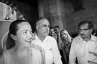 COMO, ITALY - 21 JUNE 2017: (L-R) Giorgia Meloni (leader of the Fratelli d'Italia party), Mario Landriscina (the leading candidate for Mayor of Como who wants to close the migrants reception center), and Ignazio La Russa (a lawmaker of the Fratelli d'Italia party), are seen here at the end of Mr Landriscina's rally in Como, Italy, on June 21st 2017.<br /> <br /> Residents of Como are worried that funds redirected to migrants deprived the town's handicapped of services and complained that any protest prompted accusations of racism.<br /> <br /> Throughout Italy, run-off mayoral elections on Sunday will be considered bellwethers for upcoming national elections and immigration has again emerged as a burning issue.<br /> <br /> Italy has registered more than 70,000 migrants this year, 27 percent more than it did by this time in 2016, when a record 181,000 migrants arrived. Waves of migrants continue to make the perilous, and often fatal, crossing to southern Italy from Africa, South Asia and the Middle East, seeing Italy as the gateway to Europe.<br /> <br /> While migrants spoke of their appreciation of Italy's humanitarian efforts to save them from the Mediterranean Sea, they also expressed exhaustion with the country's intricate web of permits and papers and European rules that required them to stay in the country that first documented them.