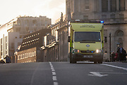 Ambulance crossed Lambeth Bridge, closed in the aftermath of the terrorism event when four people were killed (including the attacker) and 20 injured during a terrorist attack on Westminster Bridge and outside the Houses of Parliament, on 22nd March 2017, in central London, England. Parliament was in session and all MPs and staff and visitors were in lock-down while outside, the public and traffic were kept away from the area of Westminster Bridge and parliament Square, the scenes of the attack. It is believed a lone man crashed his car into pedestrians then, armed with a knife tried to enter Parliament, stabbing and killing a police officer at parliament's main gates.