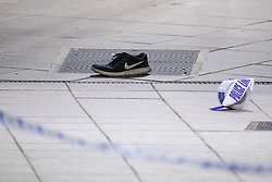 © Licensed to London News Pictures . FILE PICTURE DATED 31/12/2018 of a shoe on a platform at Victoria Station in Manchester as Mahdi Mohamud is due to appear at Manchester Crown Court today (Tuesday 26 November 2019) charged  with 3 counts of attempted murder and 1 count contrary to Section 58 (1) (a), TACT 2000 which relates to the possession of a document or record likely to be useful to a person committing or preparing an act of terrorism . On the evening of 31st December 2018 , as thousands headed in to Manchester City Centre to watch New Years Day fireworks , three people including a British Transport Police Officer were stabbed and a man was tasered on a Metrolink platform of Victoria Train Station in Manchester . Photo credit : Joel Goodman/LNP