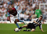 Photo: Rich Eaton.<br /> <br /> Aston Villa v Newcastle United. The Barclays Premiership. 27/08/2006. Luke Moore of Aston Villa is tackled by Newcastles James Milner
