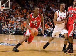 Bradley guard/forward Theron Wilson (12) in action against UVA.  The Virginia Cavaliers fell to the Bradley Braves 96-85 in the semifinals of the 2008 College Basketball Invitational at the University of Virginia's John Paul Jones Arena in Charlottesville, VA on March 26, 2008.