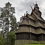 A stave church is a medieval wooden church with a post and beam construction related to timber framing.  All of the surviving stave churches except one are found in Norway, but related church types were once common all over northwestern Europe. This is the Stave Church from Gol now found in the Folk Museum in Oslo, Norway.