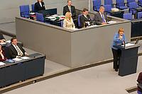 25 SEP 2003, BERLIN/GERMANY:<br /> Gerhard Schroeder (L), SPD, Bundeskanzler, und Angela Merkel (R), CDU Bundesvorsitzende, waehrend der Rede von Merkel, Bundestagsdebatte zur aktuellen lage im Irak, Plenum, Deutscher Bundestag<br /> IMAGE: 20030925-01-071<br /> KEYWORDS: speech, Gerhard Schröder