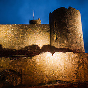 The heavily fortified walls of Harlech Castle in Harlech, Gwynedd, on the northwest coast of Wales next to the Irish Sea. The castle was built by Edward I in the closing decades of the 13th century as one of several castles designed to consolidate his conquest of Wales.