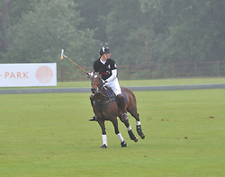 HRH The DUKE OF CAMBRIDGE playing polo at the Sentebale Polo Cup held at Coworth Park, Berkshire on 12th June 2011.