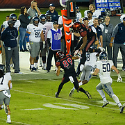 18 November 2017:  The San Diego State football team hosts Nevada Saturday night. San Diego State Aztecs running back Rashaad Penny (20) leaps over Nevada Wolf Pack defensive back Elijah Moody (18) on a rushing play in the third quarter. The Aztecs beat the Wolf Pack 42-23 at SDCCU stadium. <br /> www.sdsuaztecphotos.com
