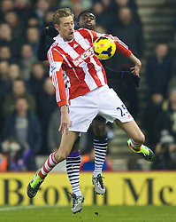 STOKE-ON-TRENT, ENGLAND - Sunday, January 12, 2014: Stoke City's Peter Crouch in action against Liverpool during the Premiership match at the Britannia Stadium. (Pic by David Rawcliffe/Propaganda)