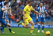MK Dons midfielder Carl Baker gets the better of Brighton player Jamie Murphy during the Sky Bet Championship match between Brighton and Hove Albion and Milton Keynes Dons at the American Express Community Stadium, Brighton and Hove, England on 7 November 2015. Photo by Bennett Dean.