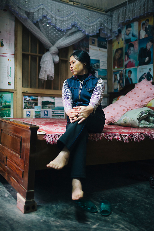 A portrait of a woman in her home in Lao Cai, Vietnam.