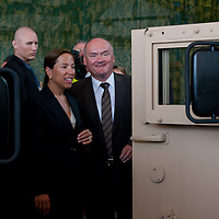 Eleni Tsakopoulos Kounalakis (L) ambassador for the United States of America and Csaba Hende (R) Defence Minister for Hungary talk next to a Hummer during the presentation of the Coalition Support Fund for Hungary by the US military in Szolnok, Hungary on July 18, 2011. ATTILA VOLGYI