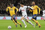 Son Heung-Min of Tottenham Hotspur (7) taking on Juventus defender Mehdi Benatia (4) and Juventus midfielder Blaise Matuidi (14) during the Champions League match between Tottenham Hotspur and Juventus FC at Wembley Stadium, London, England on 7 March 2018. Picture by Matthew Redman.
