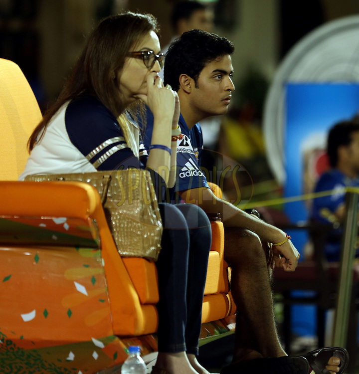 Nita Ambani owner of Mumbai Indians with her Son Aaksah during the eliminator match of the Pepsi Indian Premier League Season 2014 between the Chennai Superkings and the Mumbai Indians held at the Brabourne Stadium, Mumbai, India on the 28th May  2014<br /> <br /> Photo by Sandeep Shetty / IPL / SPORTZPICS<br /> <br /> <br /> <br /> Image use subject to terms and conditions which can be found here:  http://sportzpics.photoshelter.com/gallery/Pepsi-IPL-Image-terms-and-conditions/G00004VW1IVJ.gB0/C0000TScjhBM6ikg