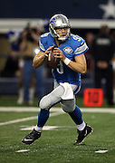 Detroit Lions quarterback Matthew Stafford (9) rolls to his right as he drops back to pass during the NFL week 18 NFC Wild Card postseason football game against the Dallas Cowboys on Sunday, Jan. 4, 2015 in Arlington, Texas. The Cowboys won the game 24-20. ©Paul Anthony Spinelli