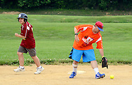 Cole Damiani (left) rounds second base as Michael Colson (right) chases down the ball during the Miracle League Festival, a softball tournament for players with intellectual and physical challenges at George School Saturday June 20, 2015 in Newtown, Pennsylvania. (Photo by William Thomas Cain)