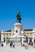 Tourists photographing bronze statue of Jose I on horseback - Portugal's king in Praca do Comercio -Terreiro do Paço, in Lisbon, Portugal
