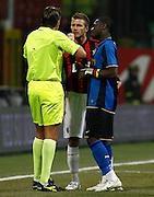"L'arbitro Rosetti, David Beckham (Milan) argues with Sulley Muntari (Inter).Milano 15/2/2009 Stadio ""Giuseppe Meazza"".Campionato Italiano Serie A.Inter Milan"