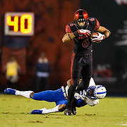 12 October 2018: San Diego State Aztecs wide receiver Tim Wilson Jr. (6) is tripped up after making a catch for a first down in the second quarter. The San Diego State Aztecs lead 14-9 at the half against the Air Force Falcons at SDCCU Stadium Friday night.