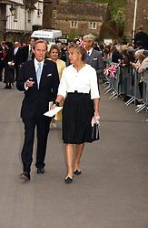 The MARQUESS & MARCHIONESS OF DOURO at the wedding of Laura Parker Bowles to Harry Lopes held at Lacock, Wiltshire on 6th May 2006.<br />