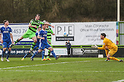 Forest Green Rovers Christian Doidge(9) shoots at goal Macclesfield's goalkeeper Scott Flinders makes a save during the Vanarama National League match between Forest Green Rovers and Macclesfield Town at the New Lawn, Forest Green, United Kingdom on 4 March 2017. Photo by Shane Healey.