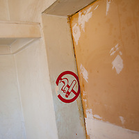 TAMPA, FL -- March 22, 2011 -- A non-smoking sticker is seen in a vacant home that smells that smoke in North Port, Fla., 2011.  A recent study showed that one and five homes in the state of Florida is vacant.