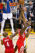 Golden State Warriors forward Kevon Looney (5) tips the ball into the basket against the Houston Rockets during Game 6 of the Western Conference Finals at Oracle Arena in Oakland, Calif., on May 26, 2018. (Stan Olszewski/Special to S.F. Examiner)
