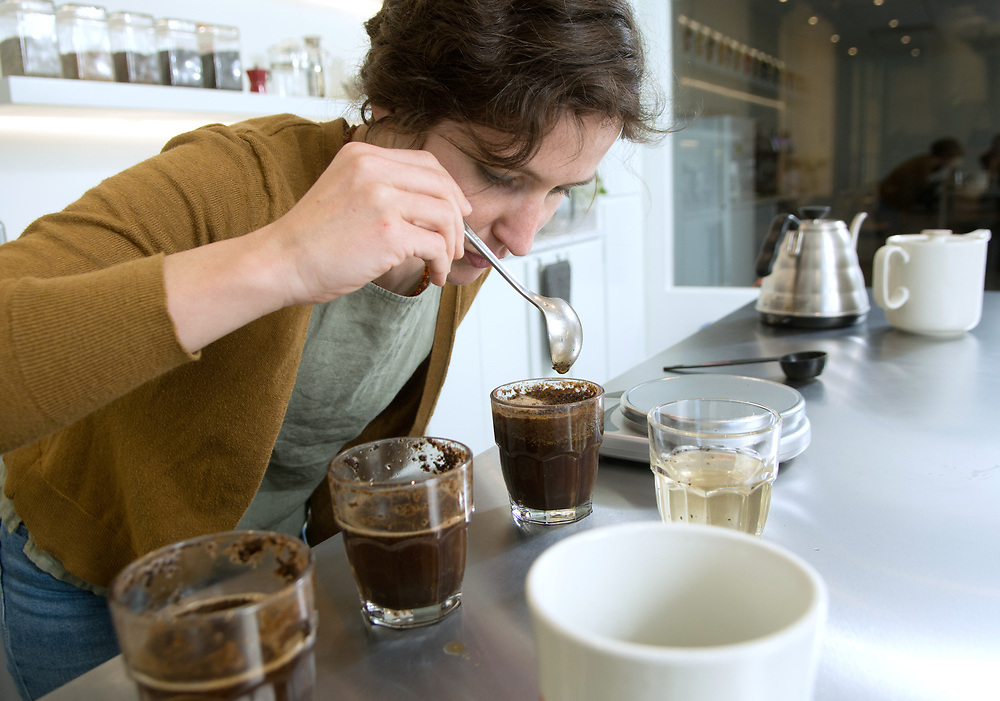 mkb031617e/metro/Marla Brose --  <br /> Rachel Langer inhales the aroma of a sample of coffee, called cupping, in the new tasting room of Red Rock Roasters. The tasting room will also be used for classes. (Marla Brose/Albuquerque Journal)